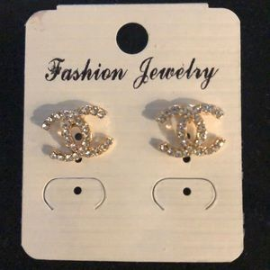 Fashion jewelry earrings with Chanel logo